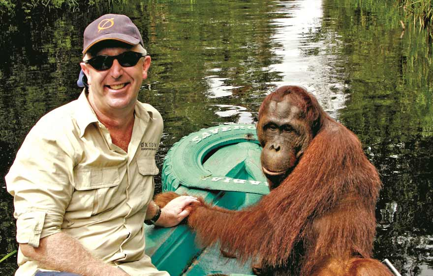 borneo-mick-fogg-and-orangutan-at-camp-leakey-orion-expeditions.jpg